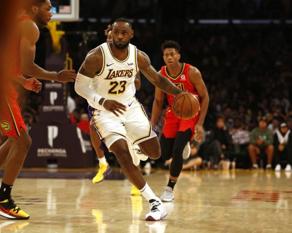 LeBron James #23 of the Los Angeles Lakers moves the ball down the court during the second half of a game against the Atlanta Hawks at Staples Center on November 17, 2019 in Los Angeles, California. PHOTO | AFP