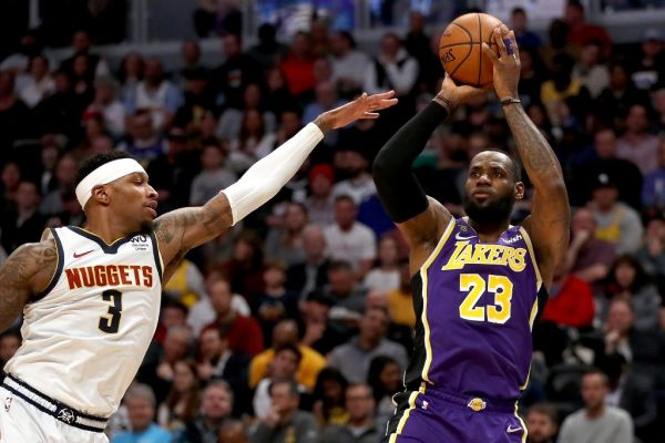 LeBron James #23 of the Los Angeles Lakers puts up a shot against Torrey Craig #3 of the Denver Nuggets in the first quarter at Pepsi Center on February 12, 2020 in Denver, Colorado. PHOTO | AFP