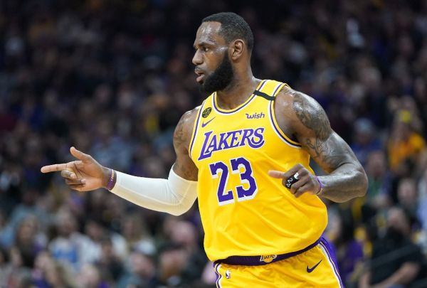 LeBron James #23 of the Los Angeles Lakers reacts after his team scored against the Sacramento Kings during the first half of an NBA basketball game at Golden 1 Center on February 01, 2020 in Sacramento, California. PHOTO \ AFP