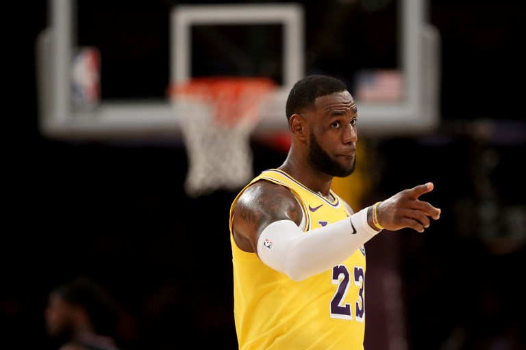 LeBron James of the Los Angeles Lakers looks on during the first half of a game against the Los Angeles Clippers at Staples Center on March 04, 2019 in Los Angeles, California. PHOTO/AFP