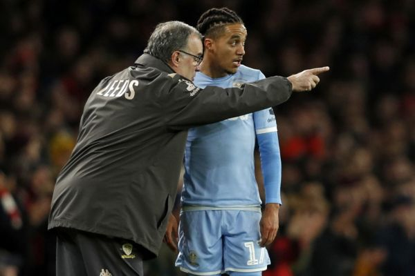 Leeds United's Argentinian head coach Marcelo Bielsa (L) speaks to Leeds United's Portuguese midfielder Helder Costa on the touchline during the English FA Cup third round football match between Arsenal and Leeds United at The Emirates Stadium in London on January 6, 2020. PHOTO | AFP