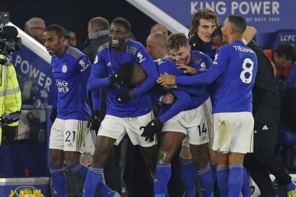 Leicester City's Nigerian striker Kelechi Iheanacho (C) celebrates with teammates after scoring their late winning goal during the English Premier League football match between Leicester City and Everton at King Power Stadium in Leicester, central England on December 1, 2019. Leicester won the game 2-1. PHOTO | AFP