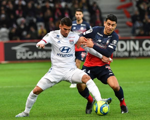 Lille's french midfielder Benjamin André vies with Lyon's midfielder Houssen Aouar during the French L1 football match between Lille (LOSC) and Lyon at the Pierre-Mauroy Stadium in Villeneuve d'Ascq, near Lille, northern France on March 8 2020. PHOTO | AFP