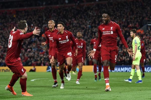Liverpool's Belgian striker Divock Origi (R) celebrates after scoring their fourth goal during the UEFA Champions league semi-final second leg football match between Liverpool and Barcelona at Anfield in Liverpool, north west England on May 7, 2019. PHOTO/AFP