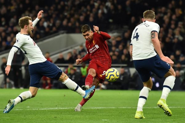 Liverpool's Brazilian midfielder Roberto Firmino (2L) shoots but sees his shot saved during the English Premier League football match between Tottenham Hotspur and Liverpool at Tottenham Hotspur Stadium in London, on January 11, 2020. PHOTO | AFP