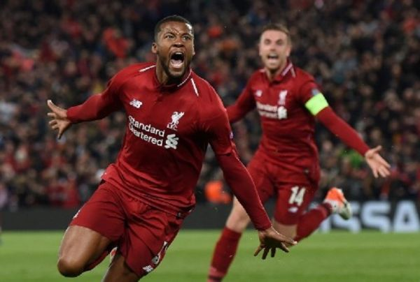 Liverpool's Dutch midfielder Georginio Wijnaldum celebrates after scoring their third goal during the UEFA Champions league semi-final second leg football match between Liverpool and Barcelona at Anfield in Liverpool, north west England on May 7, 2019. PHOTO/AFP