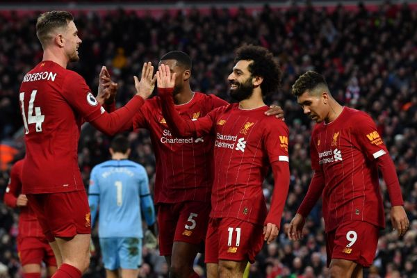 Liverpool's Egyptian midfielder Mohamed Salah (C) celebrates with teammates after scoring his team's third goal during the English Premier League football match between Liverpool and Southampton at Anfield in Liverpool, north west England on February 1, 2020. PHOTO | AFP