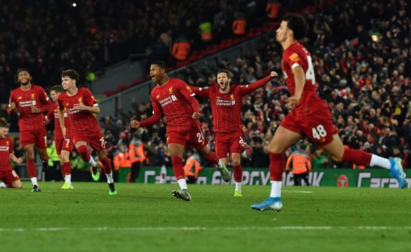 Liverpool's English midfielder Curtis Jones (R) celebrates after scoring the winning penalty in a penalty shoot-out during the English League Cup fourth round football match between Liverpool and Arsenal at Anfield in Liverpool, north west England on October 30, 2019. Liverpool won the match after winning the penalty shoot out, following a 5-5 draw in the match. PHOTO | AFP