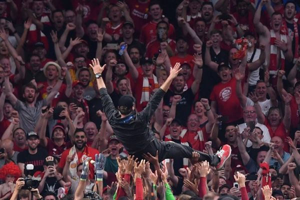 Liverpool's players throw Liverpool's German manager Jurgen Klopp in the air after winning the UEFA Champions League final football match between Liverpool and Tottenham Hotspur at the Wanda Metropolitano Stadium in Madrid on June 1, 2019. PHOTO   AFP