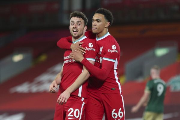 Liverpool's Portuguese striker Diogo Jota (L) celebrates scoring their second goal with Liverpool's English defender Trent Alexander-Arnold (R) during the English Premier League football match between Liverpool and Sheffield United at Anfield in Liverpool, north west England on October 24, 2020. PHOTO | AFP