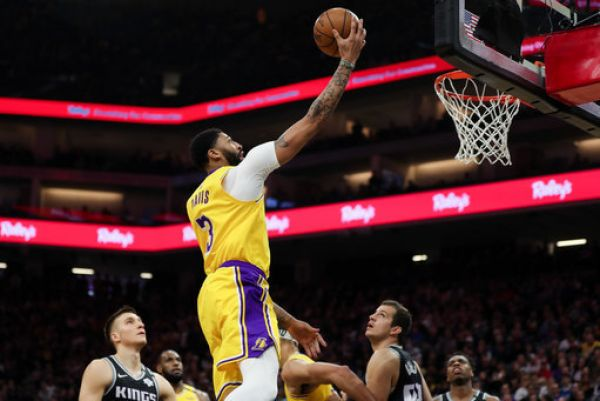 Los Angeles Lakers forward Anthony Davis (3) shoots the ball past Sacramento Kings guard Bogdan Bogdanovic (8) during the first quarter at Golden 1 Center. PHOTO | PA Images
