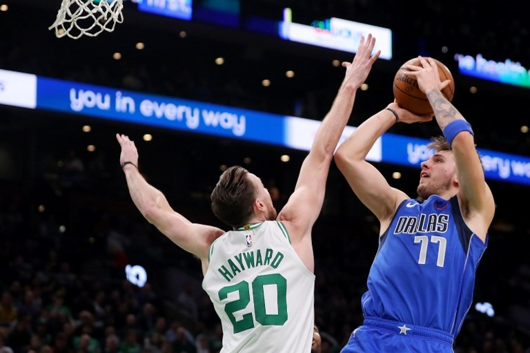 Luka Doncic (right) of the Dallas Mavericks takes a shot over Gordon Hayward #20 of the Boston Celtics during the first half at TD Garden on January 04, 2019 in Boston, Massachusetts. PHOTO/AFP