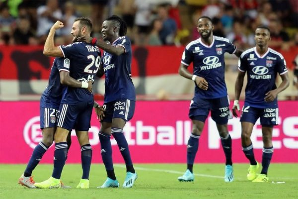 Lyon's French midfielder Lucas Tousart (L) celebrates after scoring the 0-3 goal during the French L1 football match between AS Monaco (ASM) and Olympique Lyonnais (OL) at the Stade Louis II stadium in Monaco on August 9, 2019. PHOTO | AFP