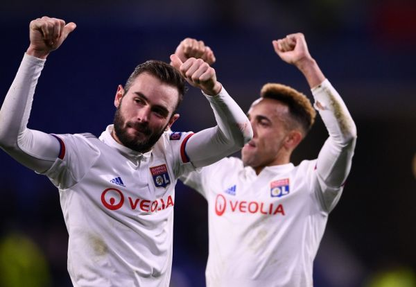Lyon's French midfielder Lucas Tousart (L) celebrates at the end of the UEFA Champions League round of 16 first-leg football match between Lyon and Juventus at the Parc Olympique Lyonnais stadium in Decines-Charpieu, central-eastern France, on February 26, 2020. PHOTO   AFP
