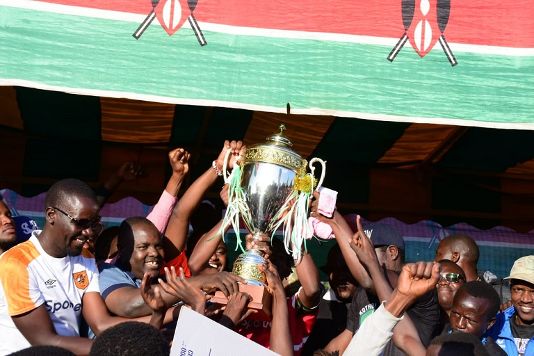 Makadara MP George Aladwa hands over the trophy to 2018 Koth Biro tournament champions, Cinema FC at Ziwani Grounds in Nairobi on January 5, 2019. PHOTO/SPN