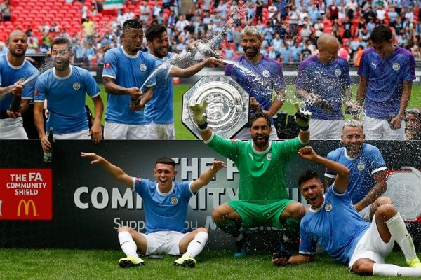 Manchester City players celebrate with the trophy during the presentation after winning the English FA Community Shield football match between Manchester City and Liverpool at Wembley Stadium in north London on August 4, 2019. PHOTO | AFP