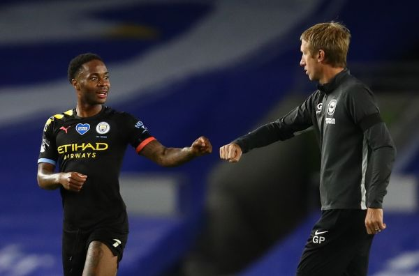 Manchester City's English midfielder Raheem Sterling (L) fist pumps Brighton's English manager Graham Potter after the English Premier League football match between Brighton and Hove Albion and Manchester City at the American Express Community Stadium in Brighton, southern England on July 11, 2020. PHOTO | AFP