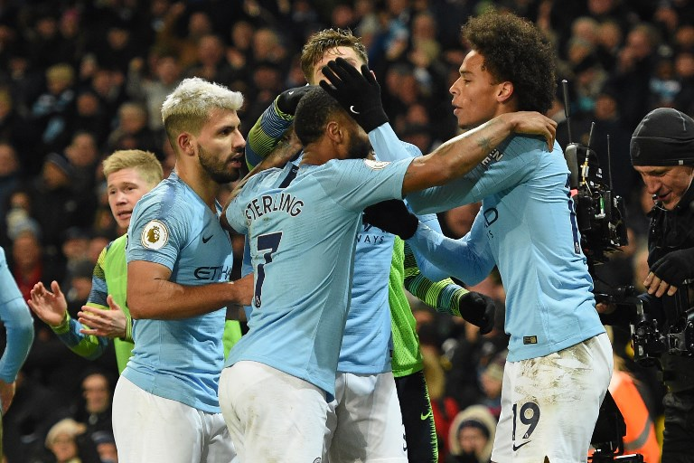 Manchester City's German midfielder Leroy Sane (R) celebrates with teammates after scoring their second goal during the English Premier League football match between Manchester City and Liverpool at the Etihad Stadium in Manchester, north west England, on January 3, 2019.