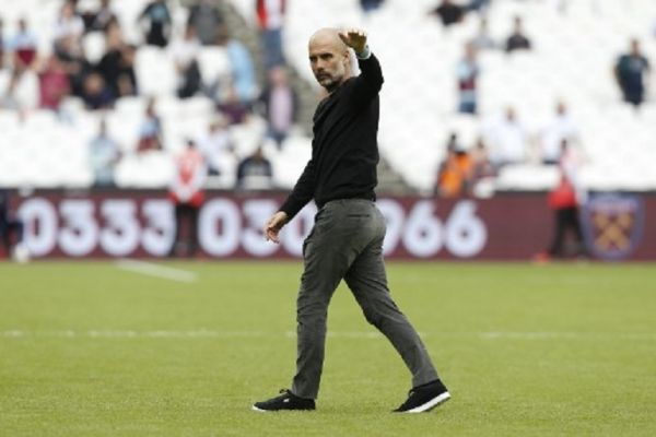 Manchester City's Spanish manager Pep Guardiola waves at the end of the English Premier League football match between West Ham United and Manchester City at The London Stadium, in east London on August 10, 2019. PHOTO/ AFP