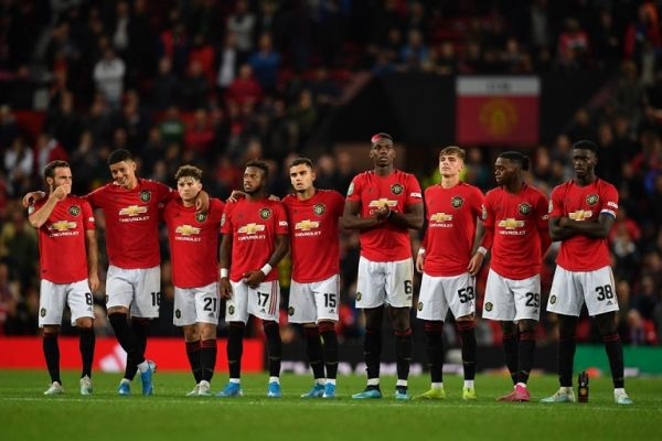 Manchester United player wait in the centre circle as penalties are taken after the game finishes 1-1 during the English League Cup third round football match between Manchester United and Rochdale at Old Trafford in Manchester, north-west England on September 25, 2019. PHOTO | AFP