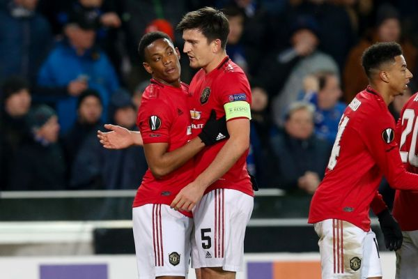 Manchester United's Anthony Martial celebrates with Manchester United's captain Harry Maguire after scoring during a game of the 1/16 finals of the UEFA Europa League between Belgian soccer club Club Brugge and English club Manchetser United, in Brugge, Thursday 20 February 2020.  PHOTO   AFP
