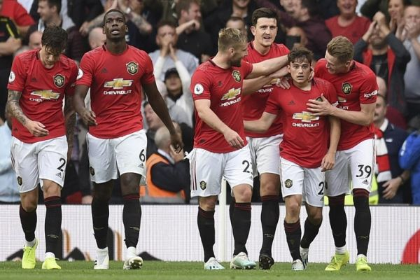 Manchester United's Daniel James (2nd R) celebrates with teammates after scoring their fourth goal on his premier league debut during the English Premier League football match between Manchester United and Chelsea at Old Trafford in Manchester, north west England, on August 11, 2019. Manchester United won the game 4--0. PHOTO | AFP