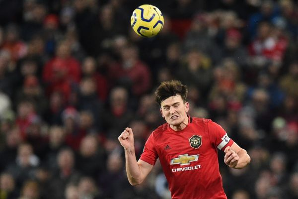 Manchester United's English defender Harry Maguire heads the ball during the English Premier League football match between Manchester United and Aston Villa at Old Trafford in Manchester, north west England, on December 1, 2019. PHOTO | AFP