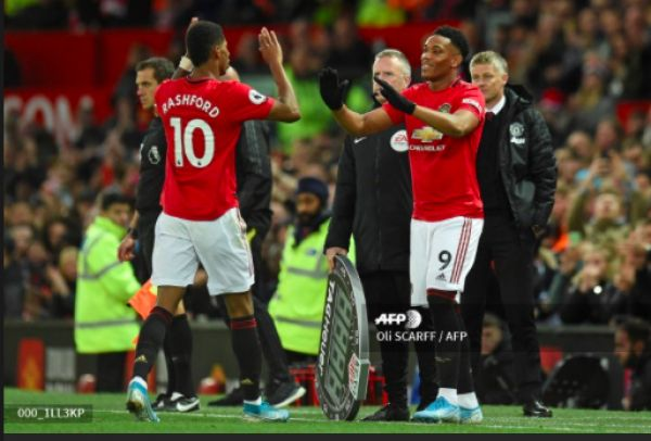 Manchester United's English striker Marcus Rashford (L) is substituted for Manchester United's French striker Anthony Martial (R) during the English Premier League football match between Manchester United and Liverpool at Old Trafford in Manchester, north west England, on October 20, 2019. PHOTO | AFP