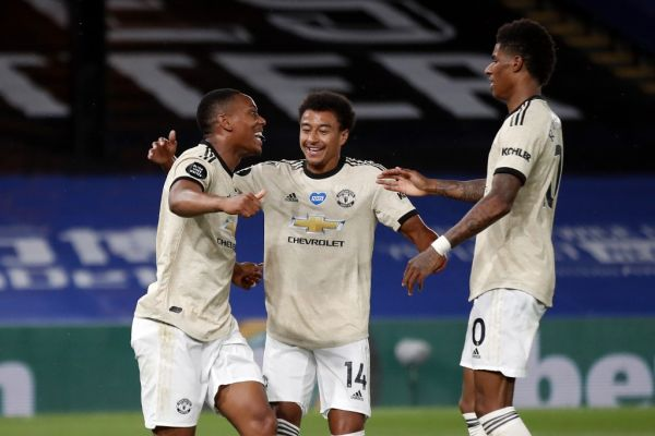 Manchester United's French striker Anthony Martial (L) celebrates with teammates after scoring their second goal during the English Premier League football match between Crystal Palace and Manchester United at Selhurst Park in south London on July 16, 2020. PHOTO   AFP