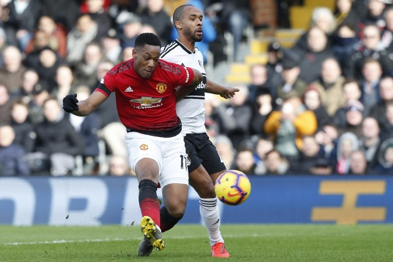Manchester United's French striker Anthony Martial shoots to score their second goal during the English Premier League football match between Fulham and Manchester United at Craven Cottage in London on February 9, 2019. PHOTO/AFP