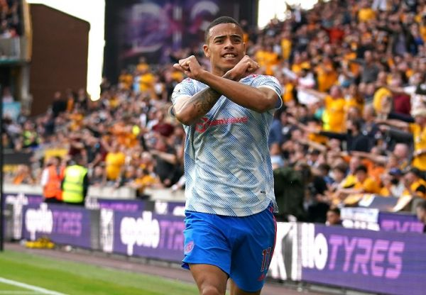 Manchester United's Mason Greenwood celebrates scoring their side's first goal of the game during the Premier League match at Molineux Stadium, Wolverhampton.