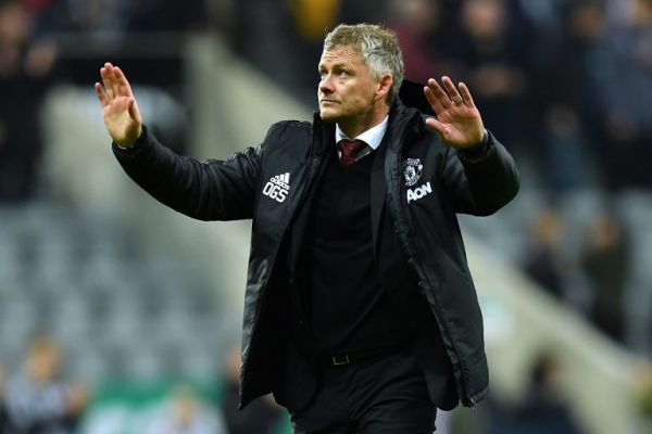 Manchester United's Norwegian manager Ole Gunnar Solskjaer gestures to supporters on the pitch after the English Premier League football match between Newcastle United and Manchester United at St James's Park in Newcastle-upon-Tyne, north east England on October 6, 2019. Newcastle won the game 1-0. PHOTO | AFP