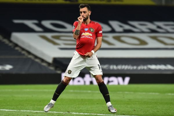 Manchester United's Portuguese midfielder Bruno Fernandes celebrates after scoring their first goal from the penalty spot during the English Premier League football match between Tottenham Hotspur and Manchester United at Tottenham Hotspur Stadium in London, on June 19, 2020. PHOTO | AFP