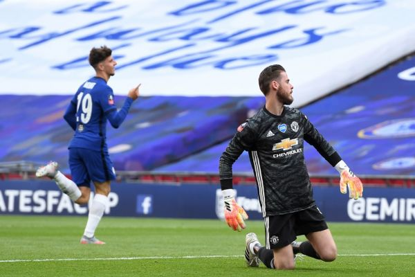 Manchester United's Spanish goalkeeper David de Gea (R) reacts as Chelsea's English midfielder Mason Mount (L) celebrates after scoring their second goal during the English FA Cup semi-final football match between Manchester United and Chelsea at Wembley Stadium in London, on July 19, 2020. PHOTO | AFP