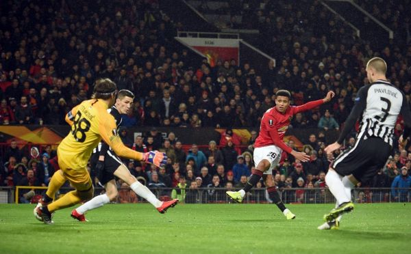 Manchester United's striker Mason Greenwood (2nd R) shoots to score the opening goal past FK Partizan's Serbian goalkeeper Vladimir Stojkovic (L) during the UEFA Europa League Group L football match between Manchester United and Partizan Belgrade at Old Trafford in Manchester, north west England, on November 7, 2019.  PHOTO | AFP