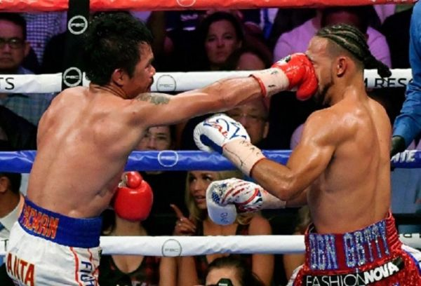Manny Pacquiao (L) hits Keith Thurman in the third round of their WBA welterweight title fight at MGM Grand Garden Arena on July 20, 2019 in Las Vegas, Nevada. PHOTO/ GETTY IMAGES