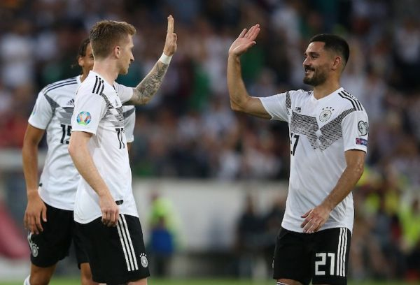 Marco Reus celebrate Germany's goal with Ilkay Gundogan (right) on Tuesday, June 11, 2019. PHOTO/AFP
