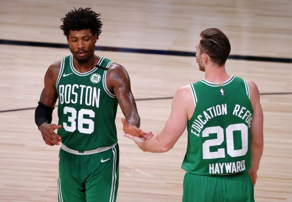 Marcus Smart #36 of the Boston Celtics and Gordon Hayward #20 of the Boston Celtics react during the fourth quarter against the Miami Heat in Game Three of the Eastern Conference Finals during the 2020 NBA Playoffs at AdventHealth Arena at the ESPN Wide World Of Sports Complex on September 19, 2020 in Lake Buena Vista, Florida. PHOTO | AFP