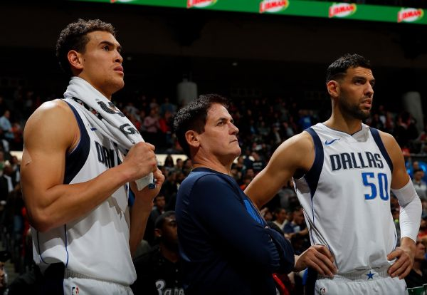 Mark Cuban, owner of the Dallas Mavericks, looks on with Dwight Powell #7 and Salah Mejri #50 in the final seconds of their 112-107 loss to the Atlanta Hawks at Philips Arena on December 23, 2017 in Atlanta, Georgia. PHOTO   AFP