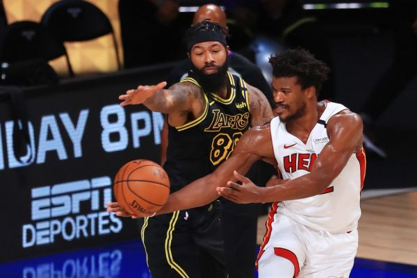 Markieff Morris #88 of the Los Angeles Lakers defends Jimmy Butler #22 of the Miami Heat during the fourth quarter in Game Five of the 2020 NBA Finals at AdventHealth Arena at the ESPN Wide World Of Sports Complex on October 9, 2020 in Lake Buena Vista, Florida. PHOTO | AFP