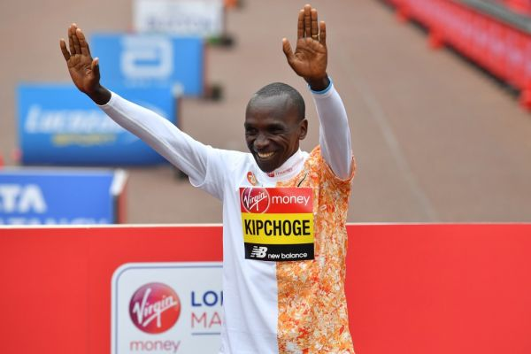 Men's race winner Kenya's Eliud Kipchoge poses for a photograph at the medal ceremony at the 2019 London Marathon in central London on April 28, 2019. Kenya's Eliud Kipchoge won the men's London Marathon on Sunday in a time of two hours two minutes and 37 seconds -- the second fastest time for any marathon. PHOTO | AFP