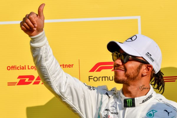 Mercedes' British driver Lewis Hamilton gives the thumbs up at the Yas Marina Circuit in Abu Dhabi, ahead of the final race of the season, on December 1, 2019. PHOTO \ AFP