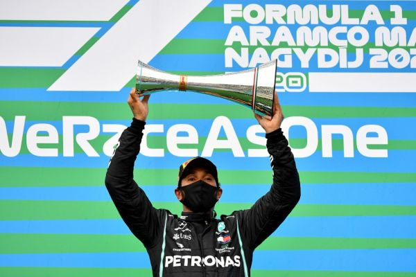 Mercedes' British driver Lewis Hamilton lifts the winning trophy after the Formula One Hungarian Grand Prix race at the Hungaroring circuit in Mogyorod near Budapest, Hungary, on July 19, 2020. PHOTO | AFP