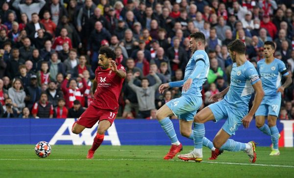 Mohamed Salah shoots to score against Manchester City. PHOTO   Alamy