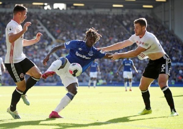 Moise Kean of Everton is challenged by Jack O'Connell of Sheffield United during the Premier League match between Everton FC and Sheffield United at Goodison Park on September 21, 2019 in Liverpool, United Kingdom. PHOTO/ GETTY IMAGES