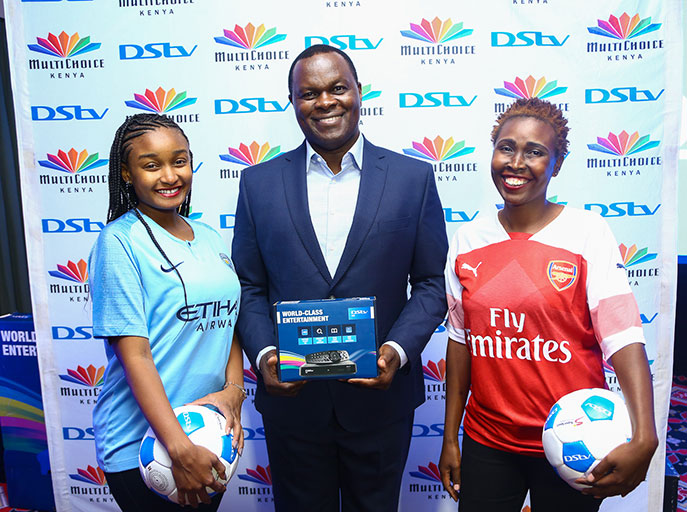 MultiChoice Kenya Managing Director, Eric Odipo, poses with models at the launch of DStv New Football Season at a Nairobi hotel on August 7, 2018.PHOTO/SPN