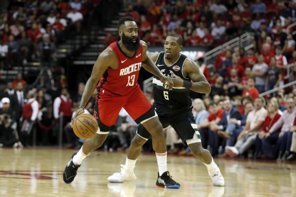 n this file photo James Harden #13 of the Houston Rockets dribbles the ball defended by Eric Bledsoe #6 of the Milwaukee Bucks in the second half at Toyota Center on October 24, 2019 in Houston, Texas. James Harden erupted for a fourth quarter scoring spree as the Houston Rockets defeated the Los Angeles Clippers 102-93 on Wednesday. PHOTO | AFP