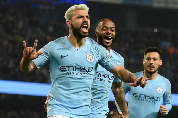 "n this file photo taken on February 27, 2019 Manchester City's Argentinian striker Sergio Aguero (L) celebrates after scoring the opening goal from the penalty spot during the English Premier League football match between Manchester City and West Ham United at the Etihad Stadium in Manchester, north west England. Premier League clubs will return to training in small groups from Tuesday after the latest stage of ""Project Restart"" was approved on Monday, May 18. PHOTO 