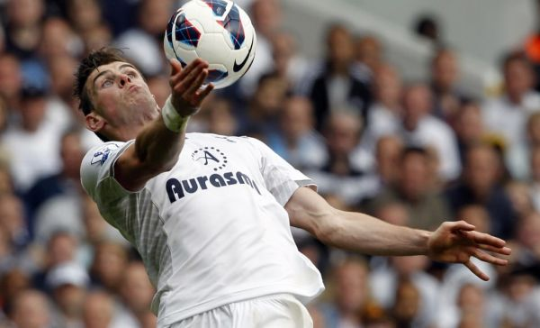 n this file photo taken on May 19, 2013 Tottenham Hotspur's Welsh midfielder Gareth Bale controls the ball during the English Premier League football match between Tottenham Hotspur and Sunderland at White Hart Lane in north London. Gareth Bale's agents are talking to Tottenham about a deal that would see the Real Madrid forward return to his former club. PHOTO | AFP