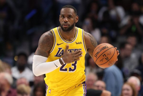 n this file photo taken on November 1, 2019 LeBron James #23 of the Los Angeles Lakers dribbles the ball at American Airlines Center in Dallas, Texas. LeBron James scored 30 points, grabbed 10 rebounds and passed off 11 assists on November 5, leading the Los Angeles Lakers to a 118-112 comeback NBA victory at Chicago with his third consecutive triple double. PHOTO | AFP